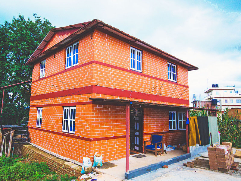 Compressed stabilized earth brick